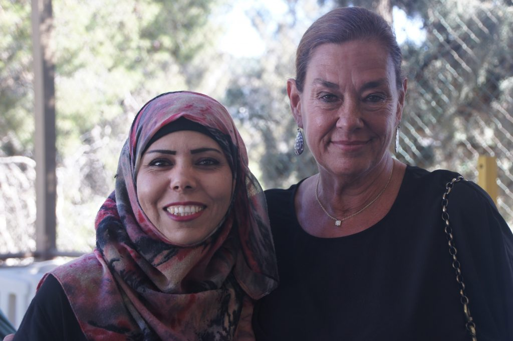 A photo of Nancy Opalack, the CEO of the foundation and a Holy Land Institute for the Deaf Teacher smiling.