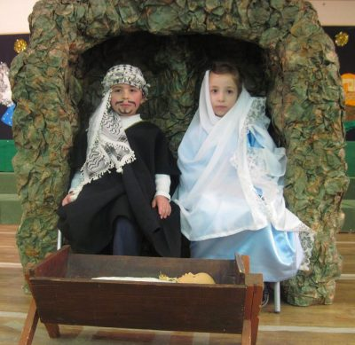 A photo of two children dressed as Mary and Joseph in the nativity.