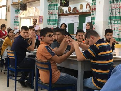 A photo of teenage male students in a classroom at Holy Land Institute for the Deaf in Jordan.