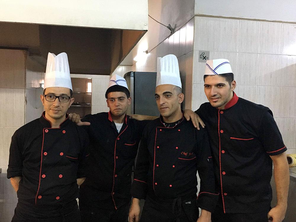 A photo of young chefs at the Schneller school