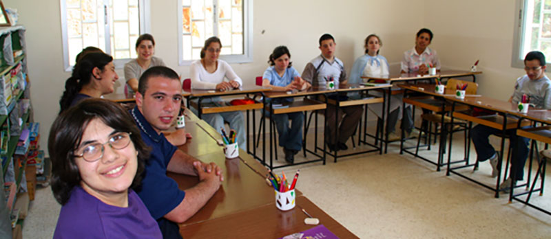 A photo of students in horshoe formation at their desks at St. Luke's Center for Rehabilitation, Beirut, Lebanon