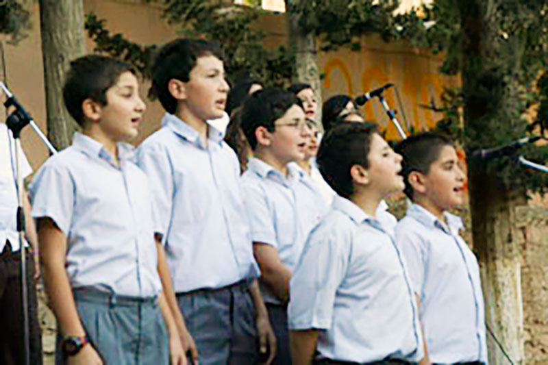 A photo of boys singing at Bishops' School in Amman, Jordan