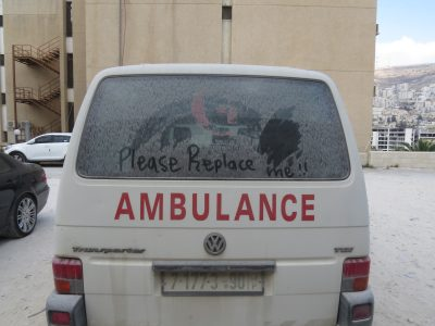 A photo of an old ambulance at St. Luke's Hospital in West Bank, Palestine.