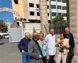 A photo of the AFEDJ Trustees in front of the Ahli Arab Hospital