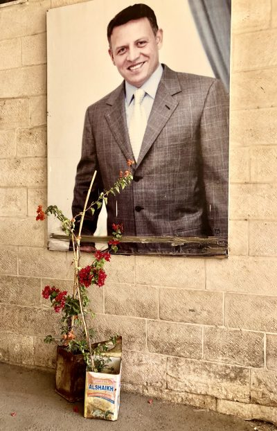 A photo of a portrait of King of Jordan, Abdallah al-Thani bin al-Hussein beside the entrance to St. Saviour's School.