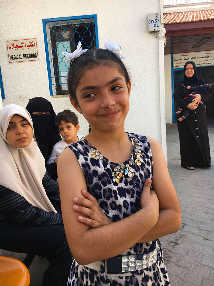 A photo of a girl smiling outside Ahli Arab Hospital