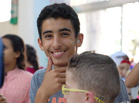 A photo of a smiling teen in school in Jerusalem