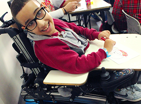 A photo of a boy in a wheelchair