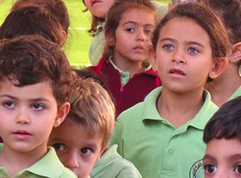 A photo of young students in playground at Arab Episcopal School