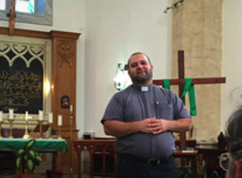A photo of a priest in a chapel at Diocese of Jerusalem