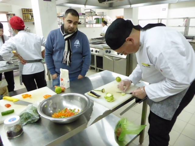 An instructor advises a culinary arts student at ETVTC.
