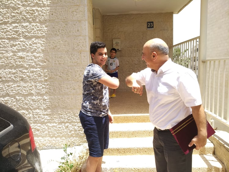 Door-to-door diploma delivery for Arab Evangelical Episcopal School seniors